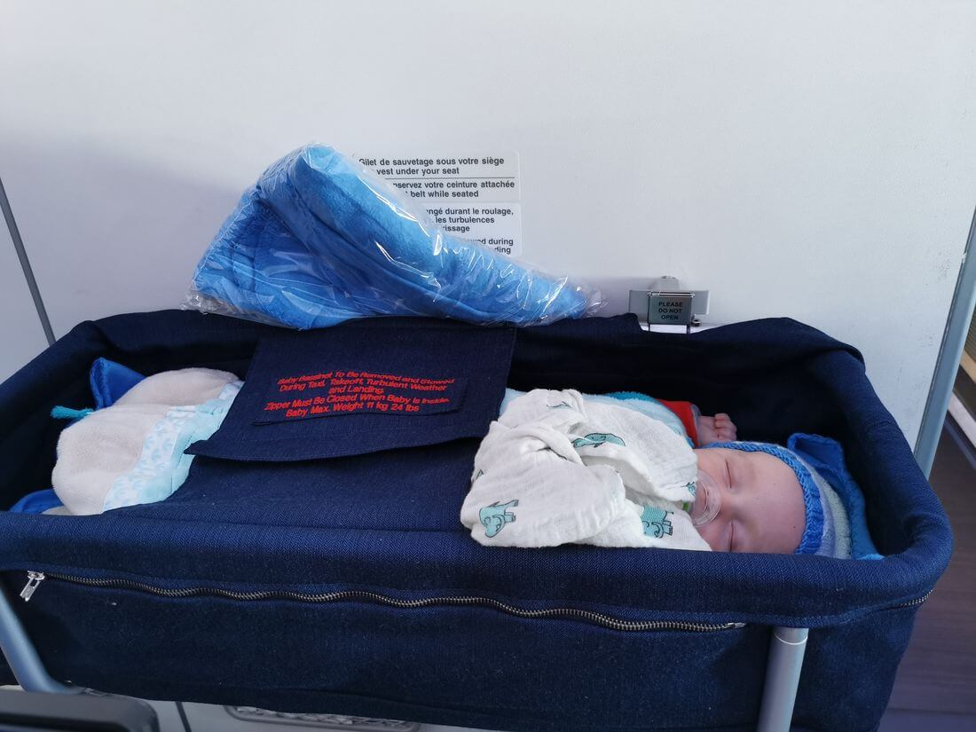 bassinet in the plane with a baby