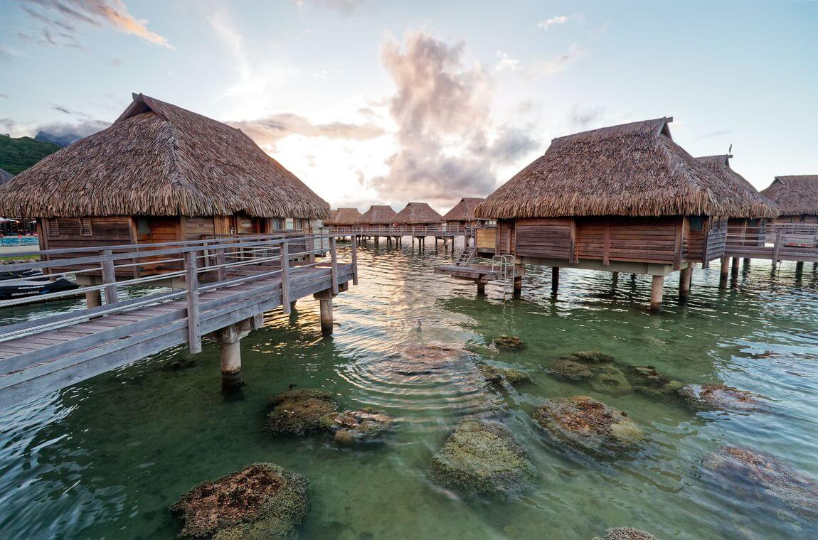 sunset manava moorea and overwater bungalows
